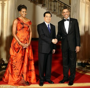 Michelle Obama has promised not to stand next to Xi Jinping during her visit