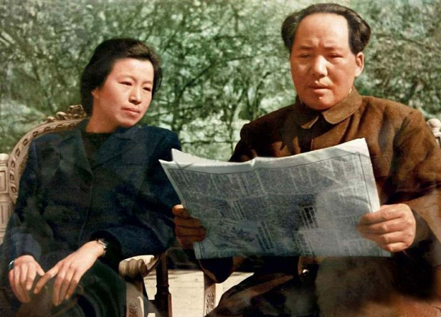 Mao scans the paper for details of serialisation rights