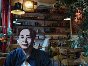 A photo purports to show Mao's phantom ordering coffee while mingling with digital nomads in an alley cafe
